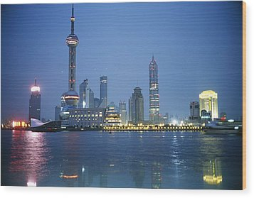 The Shanghai Skyline And Riverfront Wood Print by Raul Touzon