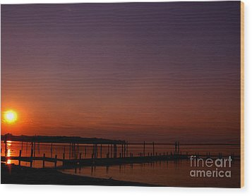 The Sun Sets Over The Water Wood Print by Clayton Bruster