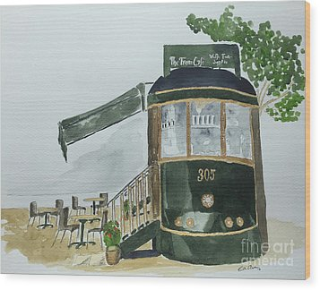 The Tram Cafe Wood Print by Eva Ason