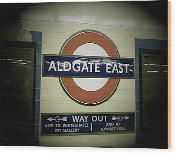 Wood Print featuring the photograph The Tube Aldgate East by Christin Brodie