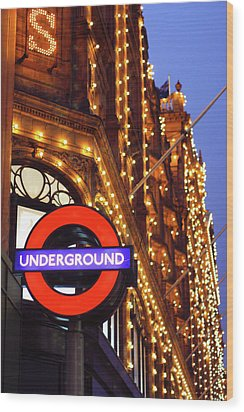 The Underground And Harrods At Night Wood Print