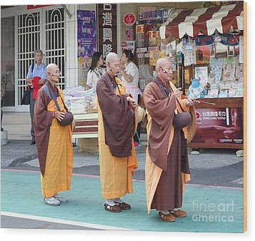 Wood Print featuring the photograph Three Buddhist Monks Chant Scriptures by Yali Shi