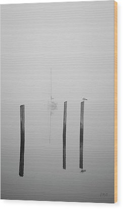 Three Pilings And Sailboat Wood Print by Dave Gordon
