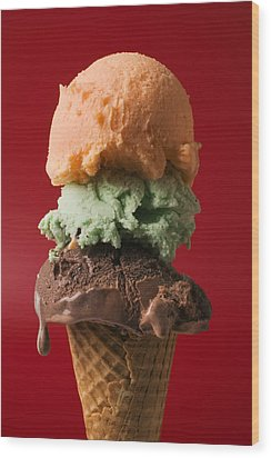 Three Scoop Ice Cream On Red Background Wood Print by Garry Gay