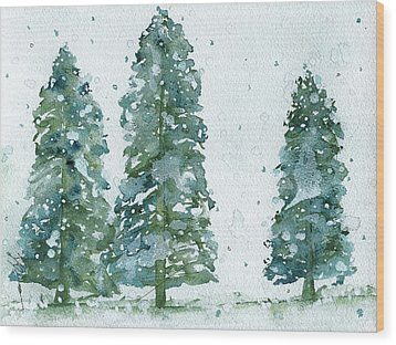 Wood Print featuring the painting Three Snowy Spruce Trees by Dawn Derman