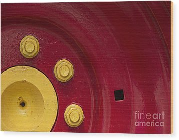 Three Yellow Nuts On A Red Wheel Wood Print by Wendy Wilton