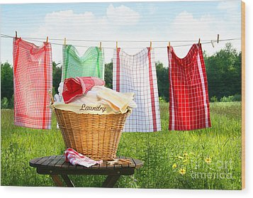 Towels Drying On The Clothesline Wood Print by Sandra Cunningham