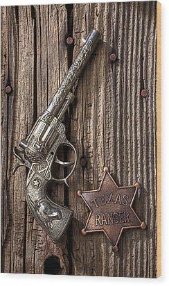 Toy Gun And Ranger Badge Wood Print by Garry Gay