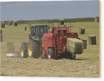 Tractor Bailing Hay At Harvest Time Wood Print by Andy Smy