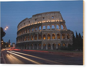 Traffic Goes By The Colosseum At Night Wood Print by Joel Sartore