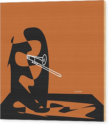 Trombone In Orange Wood Print by David Bridburg