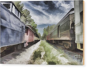 Twixt The Trains Wood Print by Roberta Byram