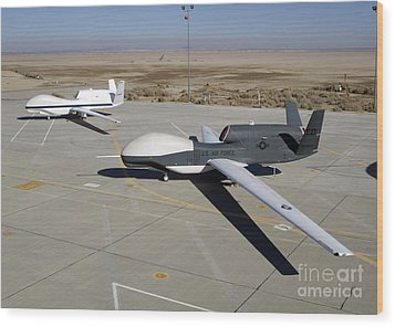 Two Global Hawks Parked On A Ramp Wood Print by Stocktrek Images