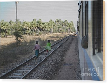 Wood Print featuring the photograph Two Kids Run Along And Follow Train In Burma by Jason Rosette