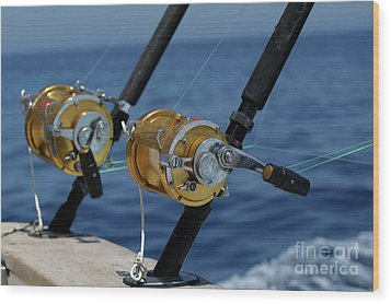 Two Rod And Reels On Board A Game Fishing Boat In The Mediterranean Sea Wood Print by Sami Sarkis