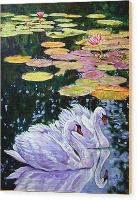 Two Swans In The Lilies Wood Print by John Lautermilch