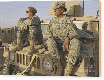 Two U.s. Army Soldiers Relax Prior Wood Print by Stocktrek Images
