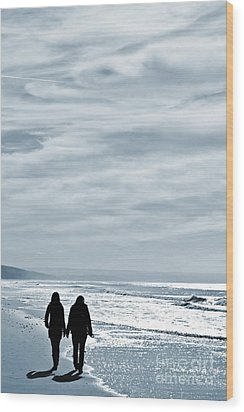 Two Women Walking At The Beach In The Winter Wood Print by Jose Elias - Sofia Pereira