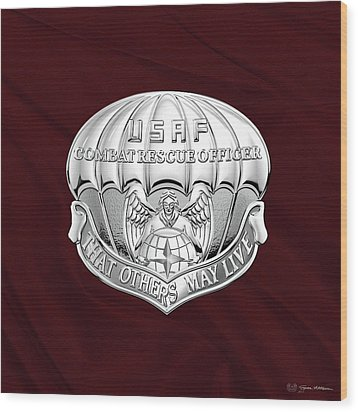 U. S.  Air Force Combat Rescue Officer - C R O Badge Over Maroon Felt Wood Print by Serge Averbukh