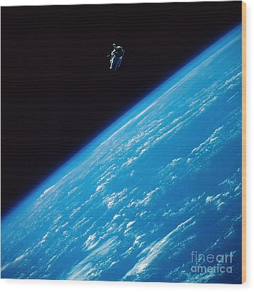Unattached Space Walk Wood Print by Stocktrek Images