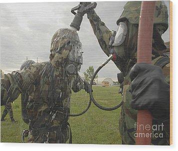 U.s. Air Force Soldier Decontaminates Wood Print by Stocktrek Images