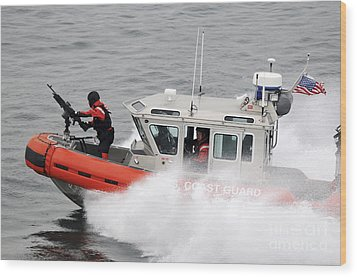 U.s. Coast Guardsmen Aboard A Security Wood Print by Stocktrek Images