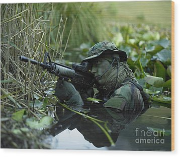U.s. Navy Seal Crosses Through A Stream Wood Print by Tom Weber