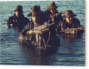 Us Navy Seal Team Emerges From Water Wood Print by Everett