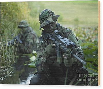 U.s. Navy Seals Cross Through A Stream Wood Print by Tom Weber
