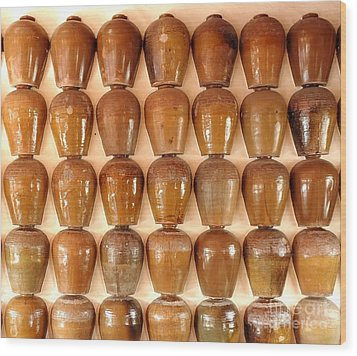 Wood Print featuring the photograph Wall Of Ceramic Jugs by Yali Shi