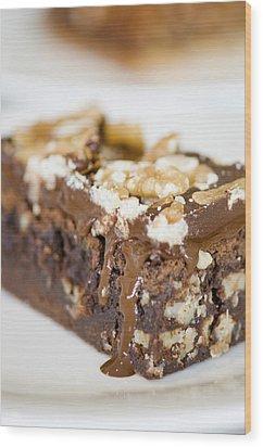 Walnut Brownie On A White Plate Wood Print