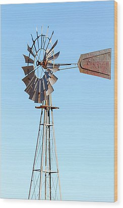 Water Pump Windmill On Blue Sky Background Wood Print by David Gn