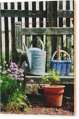 Watering Can And Blue Basket Wood Print by Susan Savad