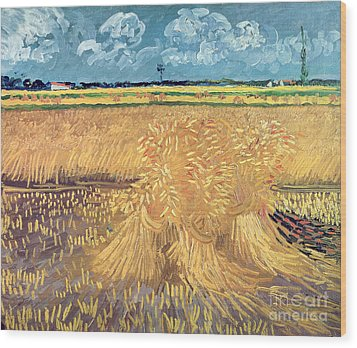 Wheatfield With Sheaves Wood Print by Vincent van Gogh
