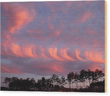 Wood Print featuring the photograph Whirlwind Salmon Clouds by Jeanne Kay Juhos