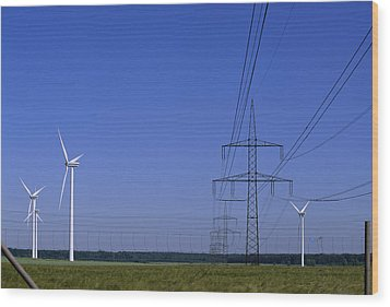 Windmills And High Voltage Transmission Wood Print by Norbert Rosing