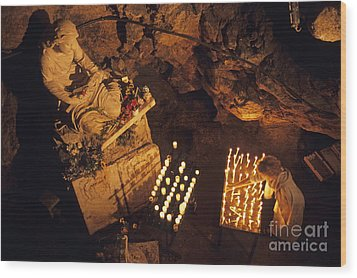 Woman Burning Candle At Troglodyte Sainte-marie Madeleine Holy Cave Wood Print by Sami Sarkis