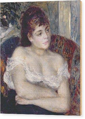 Woman In An Armchair Wood Print by Pierre Auguste Renoir