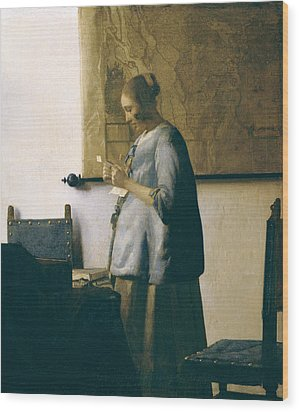 Woman Reading A Letter Wood Print by Jan Vermeer