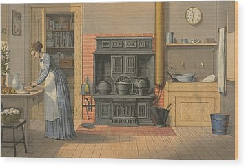 Woman Working In An Up-to-date Kitchen Wood Print by Everett