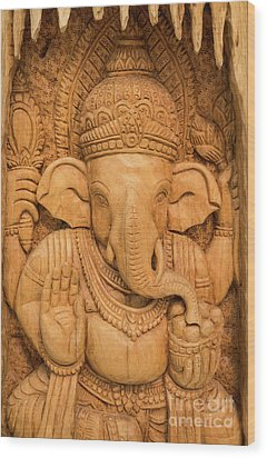 Wood Print featuring the photograph wood carving for Hindu god Ganesha on the wood. by Tosporn Preede