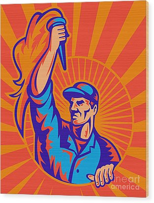 Worker Carrying Flaming Torch Sunburst Wood Print by Aloysius Patrimonio
