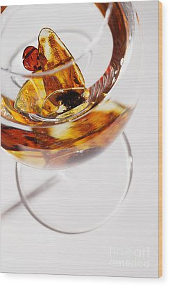 Wood Print featuring the photograph Yellow Amber Stones In A Glass. by Andrey  Godyaykin