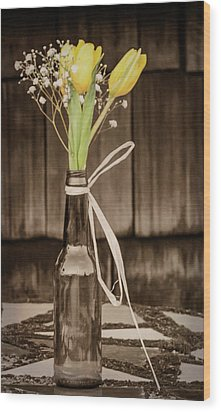 Wood Print featuring the photograph Yellow Tulips In Glass Bottle Sepia by Terry DeLuco