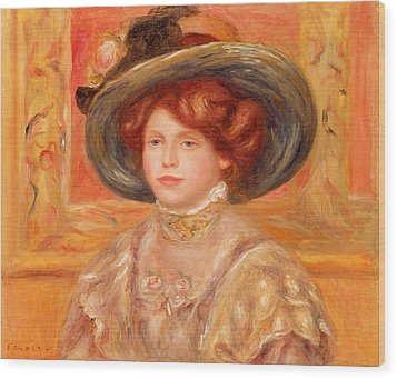 Young Woman In A Blue Hat Wood Print by Pierre Auguste Renoir
