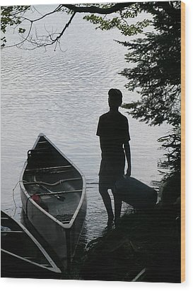 Youth With Canoe Wood Print by Jim DeLillo