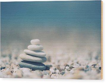 Zen Balanced Pebbles At Beach Wood Print by Alexandre Fundone
