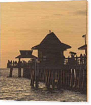 Golden Light At Naples Pier Wood Print by Ed Gleichman