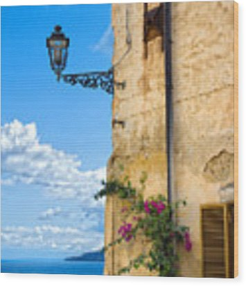 House With Bougainvillea Street Lamp And Distant Sea Wood Print by Silvia Ganora