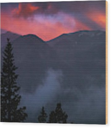 Sunset Storms Over The Rockies Wood Print by John De Bord
